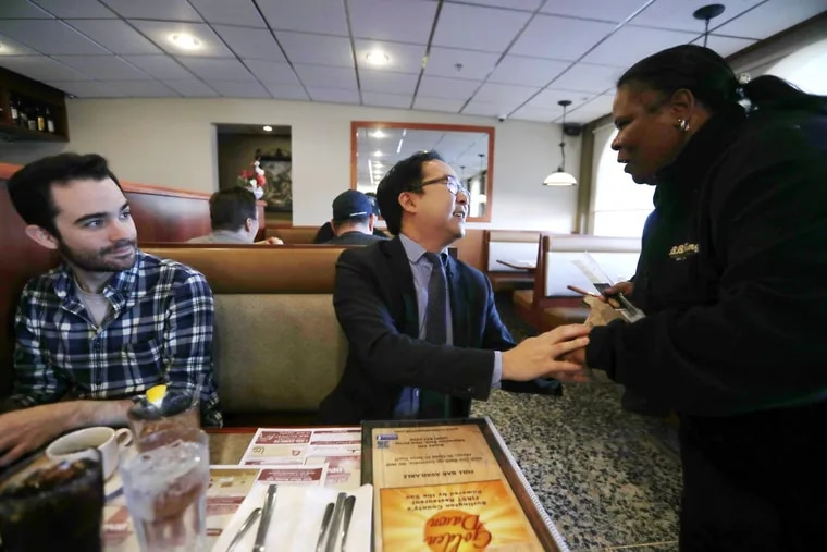 Congressman Andy Kim (D), NJ sits with reporters at Golden Dawn Diner in Burlington and meets constituents including Shirley Leary, 59, Thursday November 8, 2018.