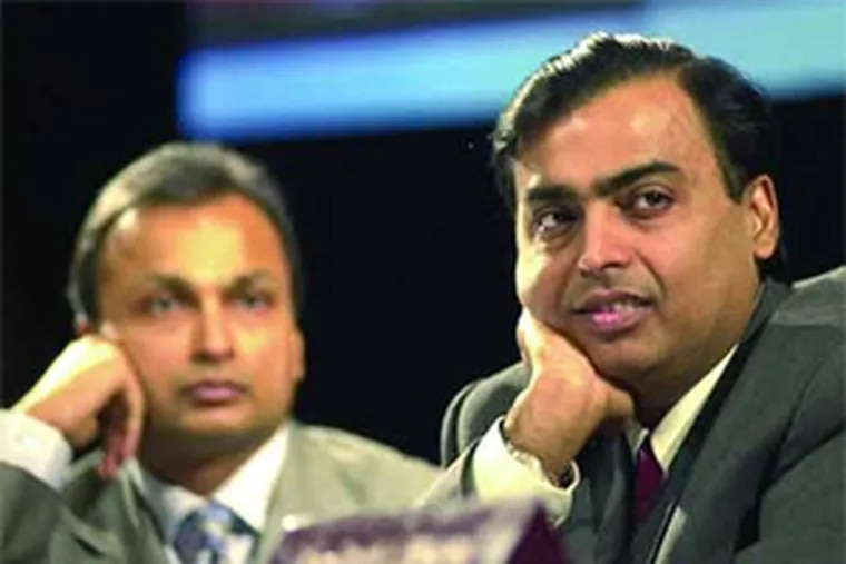 The Ambani brothers, Amil (left) and Mukesh, were ranked in March as two of the six richest people in the world. That was before their joint net worth dropped by more than $50 billion.