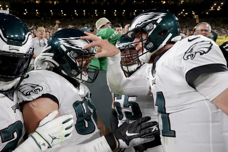 Philadelphia Eagles tight end Dallas Goedert, left, and quarterback Carson Wentz, right, celebrate Goedert's touchdown in the 2nd quarter against the Packers. Philadelphia Eagles play the Green Bay Packers at Lambeau Field in Green Bay, WI on September 26, 2019.