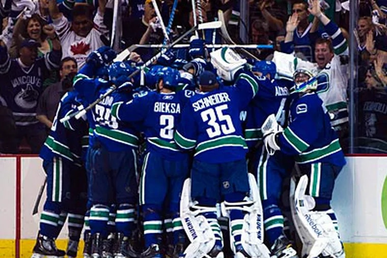 The Canucks lead the Bruins 2-0 in the Stanley Cup Finals. (AP Photo/The Canadian Press, Darryl Dyck)