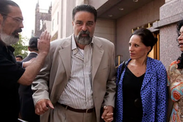 Carlos Matos is accompanied by his wife, Renee Tartaglione Matos, after sentencing in Camden on bribery charges.