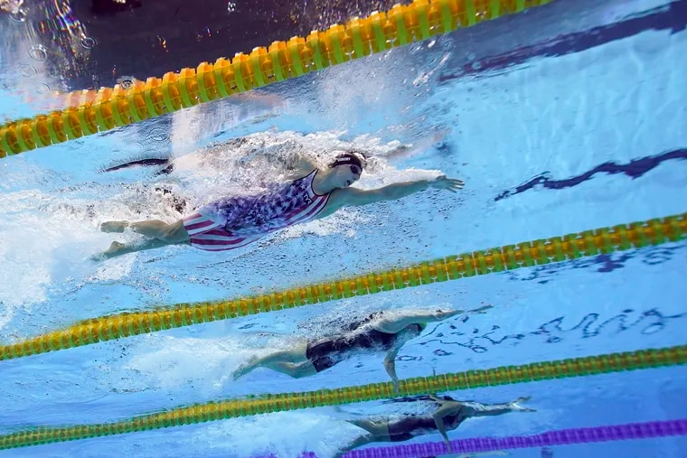 Katy Ledecky (left) swims in a 200-meter freestyle semifinal on Tuesday.