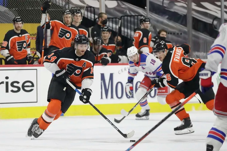Flyers center Sean Couturier (left) skates with the puck in Saturday's 2-1 win over the Rangers. Couturier has 24 points in 22 games this season.