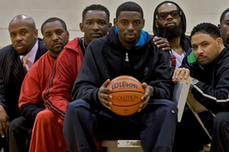 """To get to Tyreke Evans (center) you have to go through his circle of friends, which include four of his brothers, a cousin and his personal trainer/coach. """"When I need something, my brothers take care of it for me,"""" says Evans."""