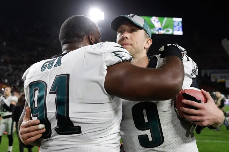 Eagles quarterback Nick Foles hugs defensive tackle Fletcher Cox after the Eagles beat the Los Angeles Rams 30-23 on Sunday, December 16, 2018 in Los Angeles.