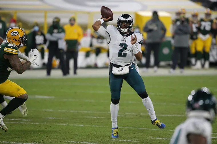 Eagles quarterback Jalen Hurts attempts a pass in the fourth quarter of Sunday's 30-16 loss to the Packers.