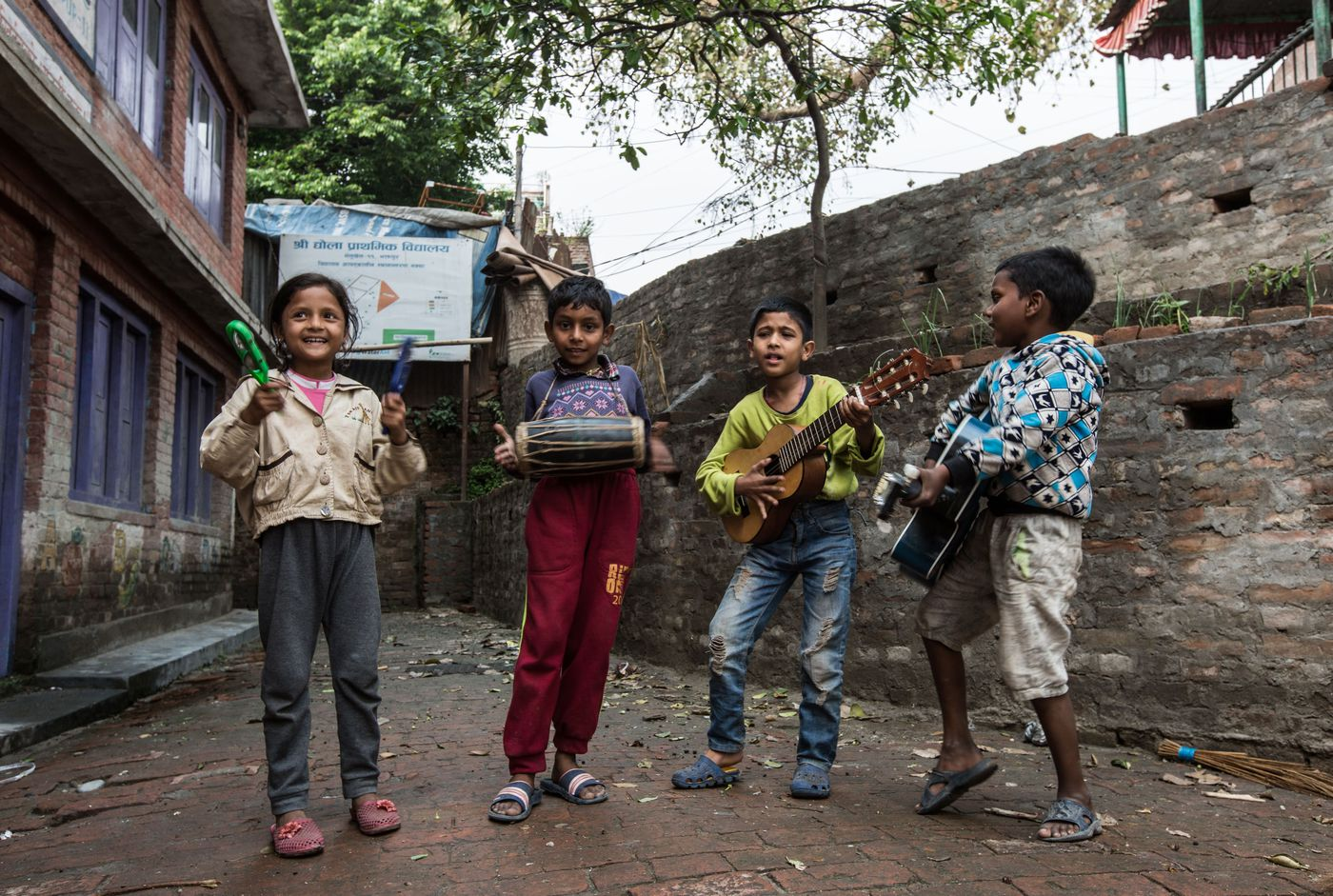 Participants at the Happy Kids Center playing music for tourists who happened to pass by. The children's instruments, along with all the toys at the center, were donated by volunteers and community members.