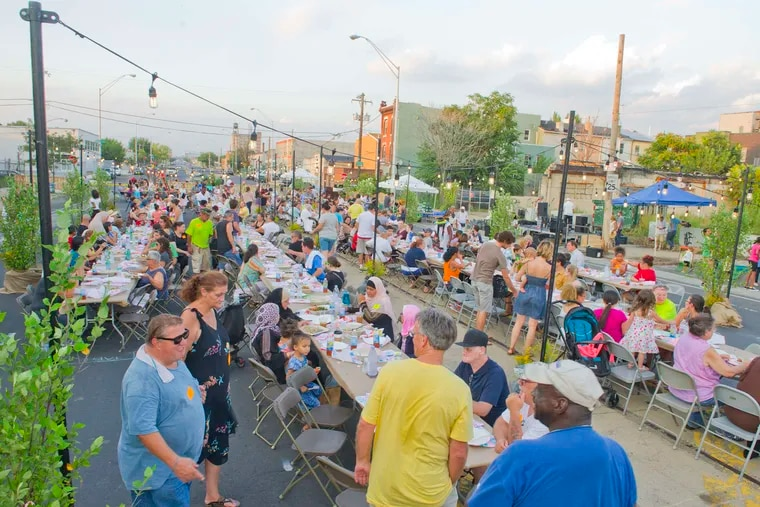 A community meal on American Street was part celebration, part peace offering over the road's future.