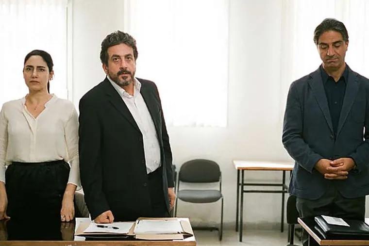 "Viviane (Ronit Elkabetz), Carmel (Menashe Noy) and Elisha (Simon Abkarian) in ""Gett."" (Courtesy of Music Box Films)"