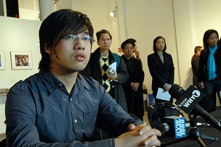 Wei Chen, a student at South Philadelphia High, addresses the media at a news conference in Chinatown earlier this month about alleged attacks at the high school. (April Saul / File photo)