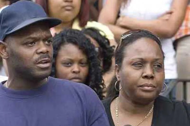 Pete Hopkins, front left, with wife, Shirley, right.  They are parents of Pete Hopkins, who was taped being beaten by police. (Jessica Griffin /  Daily News)