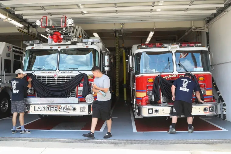 Black bunting is draped on the rescue vehicles at Belmont Hills Fire Company in memory of firefighter Tom Royds in July. Royds died and three other first responders were severely injured after a driver struck them at the scene of another car crash in the westbound lanes of I-76.