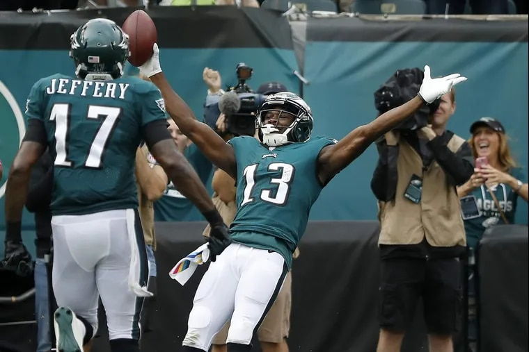 Eagles' Nelson Agholor, right, falls into the end zone for a fourth quarter touchdown against the Cardinals.