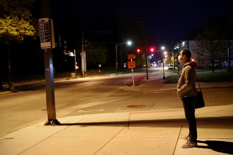 Miguel Garcia waits at a bus stop in Chester for the first leg of his commute to work in Horsham. Due to SEPTA's reduced service, Garcia has to take two subways and two buses to get to his job — a journey that takes 2½ to three hours.