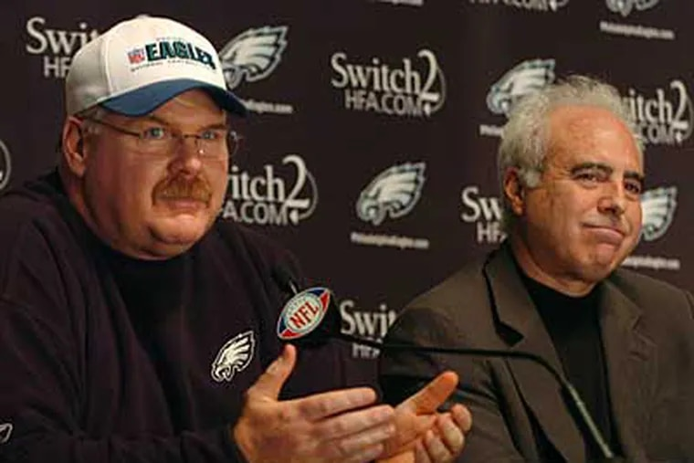 Andy Reid at a press conference, in which Jeff Lurie (right) announced his contract extension. (Sarah J. Glover / Staff Photographer)