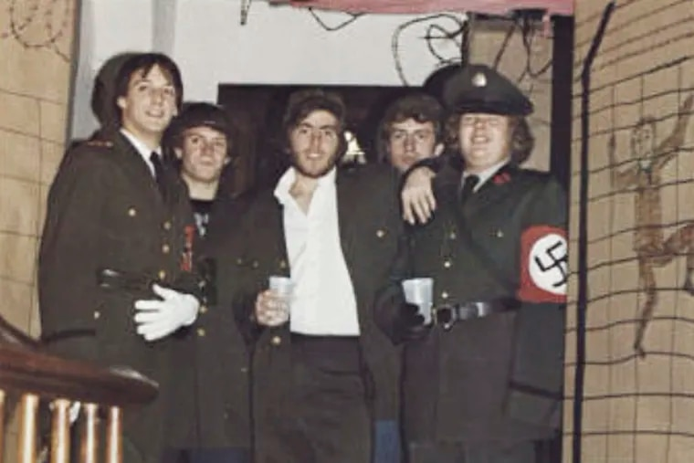 In this photo from the 1980 edition of Spectrum, the Gettysburg College yearbook, Bob Garthwait, right, wears a costume that depicts a Nazi uniform at a fraternity event. Garthwait, a financial donor and college trustee, apologized and announced his resignation from the board of trustees Tuesday, Feb. 19, 2019.