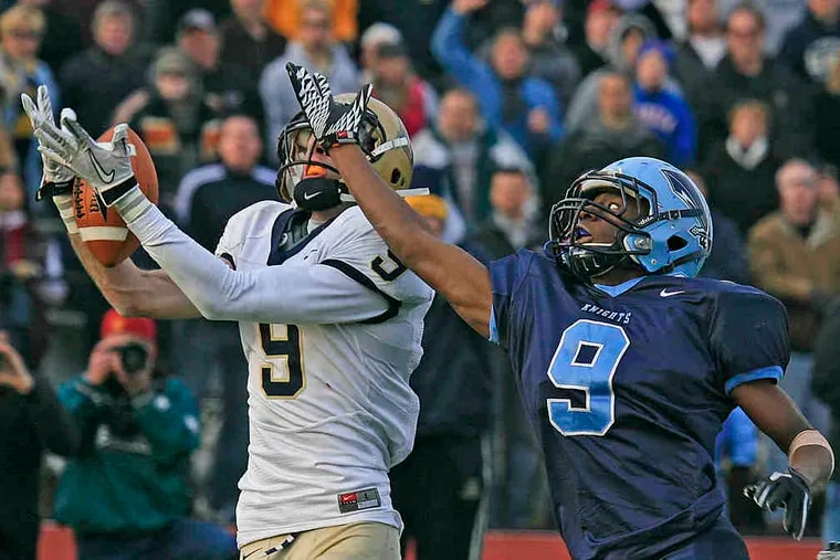 A pass slips through the hands of La Salle's Kevin Foster in the end zone in Saturday's game. North Penn's Trevell Moxey defends.