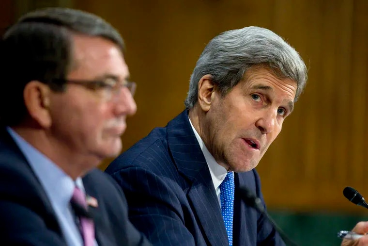 Secretary of State John Kerry (right), with defense chief Ash Carter, at a Senate panel hearing.