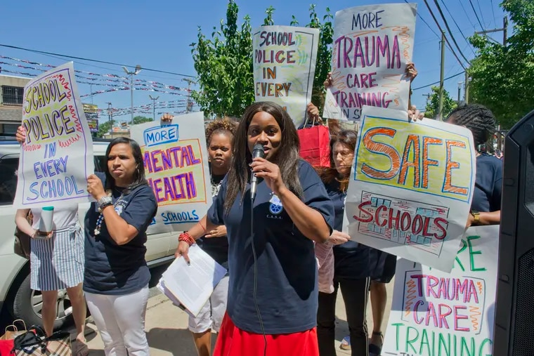 Robin Cooper, head of CASA (Commonwealth Association of School Administrators) speaks to attendees outside the Girard Academic Music Program (GAMP) school in South Philadelphia, June 15, 2018, during a rally on violence against teachers and adminstrators in Philadelphia public schools.