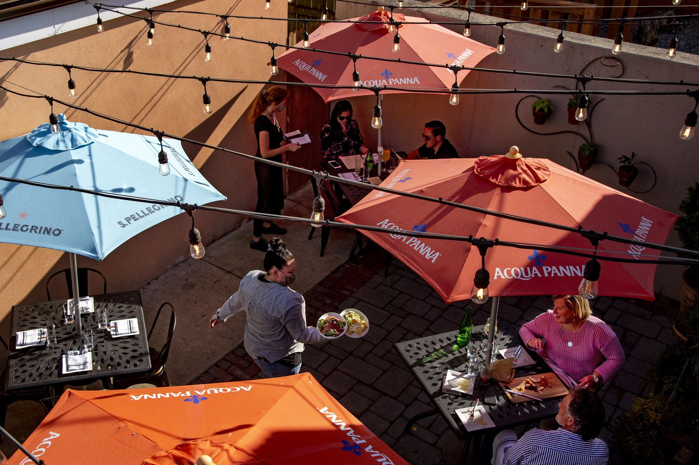 Outdoor dining returns with fresh air, umbrellas — and social distancing