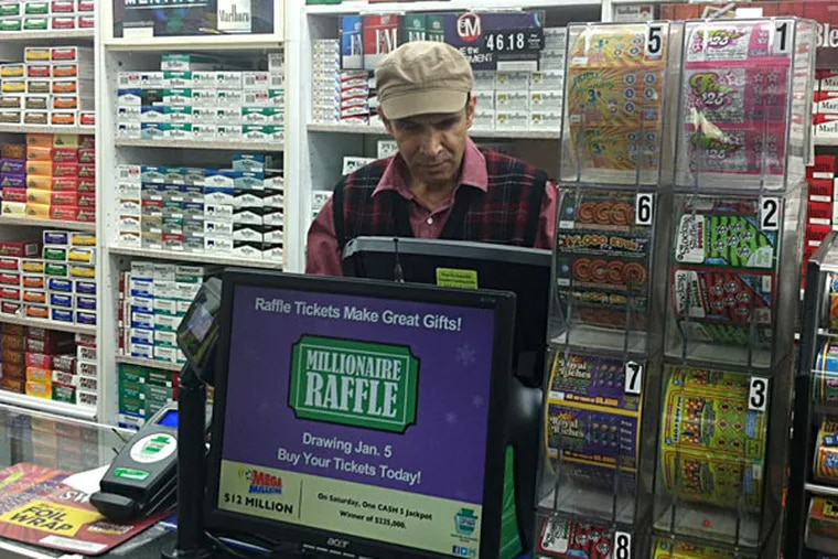 Ashok Kaul of Levittown News & Tobacco has tried to figure out which customer bought the winning ticket. BILL REED / Staff