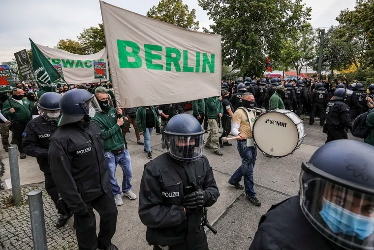Supporters of the far-right Third Way (Der Dritte Weg) neo-Nazi political party march on the 30th anniversary of German reunification in Berlin's Hohenschoenhausen district on Saturday, Oct. 3, 2020. Several radical groups, including the Third Way as well as coronavirus skeptics preaching the overthrow of the German government, are taking to the streets in Berlin. The Third Way has been active since 2013 and is an offshoot of the mostly defunct far-right NPD (National Democratic Party of Germany).