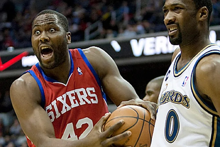 Elton Brand, left, reacts to a call after fighting for a rebound with Wizards guard Gilbert Arenas. (AP Photo/Evan Vucci)