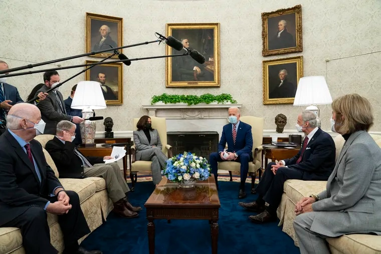 President Joe Biden (third from right) speaks during a meeting with lawmakers on investments in infrastructure in the Oval Office of the White House, on Thursday