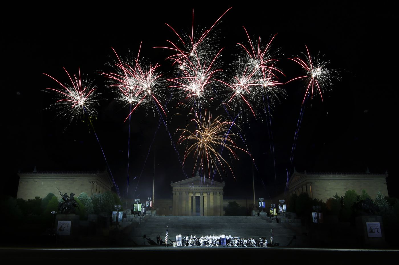 The US Army Band performs as the rockets red glare explode over the Art Museum during the Welcome America Fourth of July festivities in Phila., Pa. on July 4, 2019.