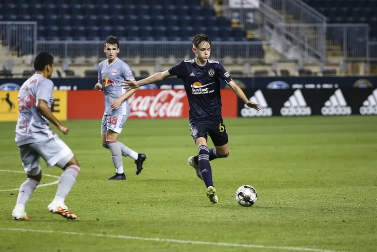Jack McGlynn, right, playing for the Union's USL team against the New York Red Bulls' USL team on Aug. 5.