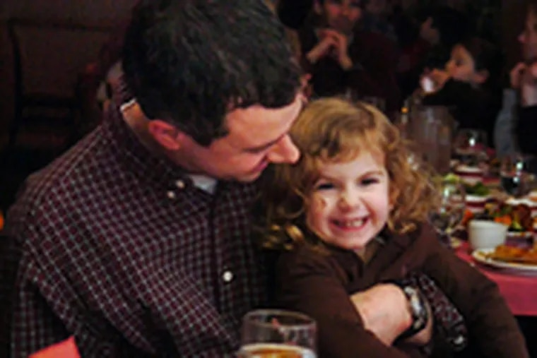 Many Jewish families go to Chinese restaurants on Christmas. Alan Susser and 3-year-old daughter Ava Susser-Stein of Haverford ate at the Singapore Kosher Vegetarian Restaurant in Chinatown.