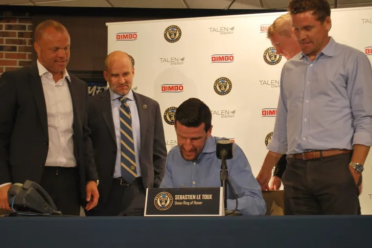 Former Philadelphia Union forward Sébastien Le Toux signed a one-day contract at Talen Energy Stadium to retire as a Union player. He was joined at the ceremony by (from left to right) sporting director Earnie Stewart, chief business officer Tim McDermott, manager Jim Curtin and technical director Chris Albright.