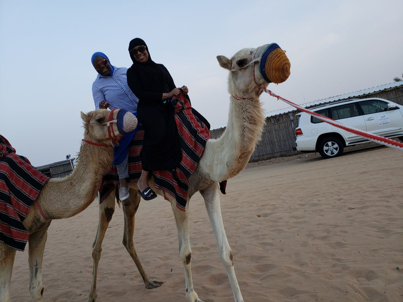 Safiya Abdullah (right) and group founder Munazza Muhammad, of the Traveling Muslimahs, ride a camel in Dubai, United Arab Emirates, April 2018.
