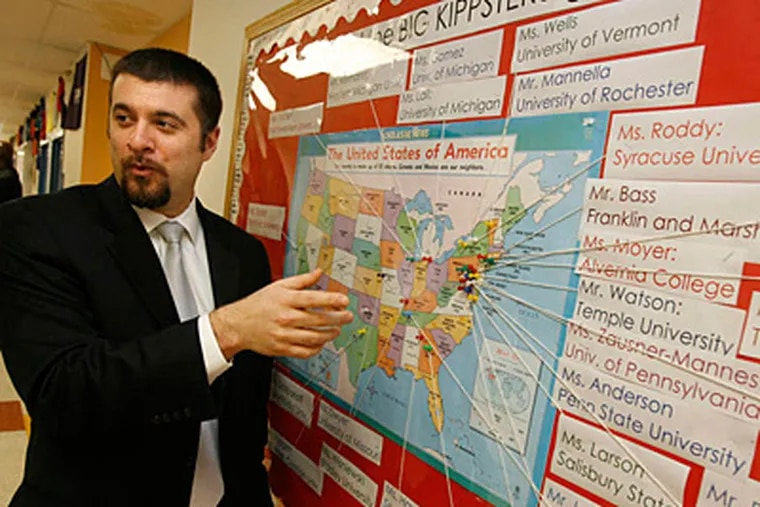 Marc Mannella, CEO of KIPP Philadelphia Schools, with a map of where KIPP Phila. teachers went to college. CHARLES FOX / Staff