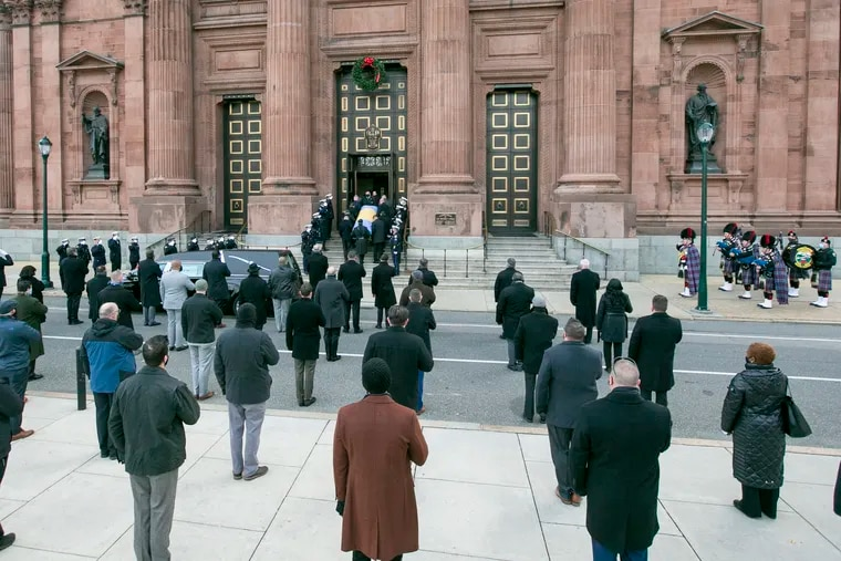 Mourners honor Southwest Detectives Commander Capt. Frank Milillo at the Cathedral Basilica of SS. Peter and Paul on Tuesday morning, December 15, 2020.