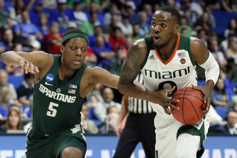 Miami guard Ja'Quan Newton (0) drives against Michigan State guard Cassius Winston during a game last season during the NCAA Tournament.
