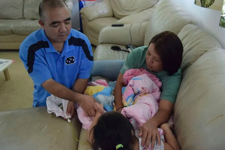 Reid Kaneshiro and his wife, Jari Sugano, of Oahu, Hawaii, administer medical marijuana in the form of oil to their daughter Maile Jen Kaneshiro, who has a rare form of epilepsy that causes her to have severe seizures.