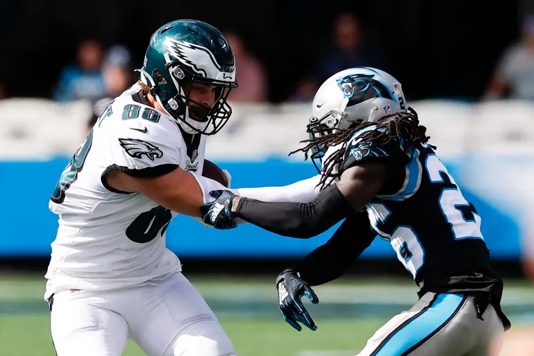 Eagles tight end Dallas Goedert shoves Carolina Panthers cornerback Donte Jackson during the third quarter on Sunday, October 10, 2021 in Charlotte.