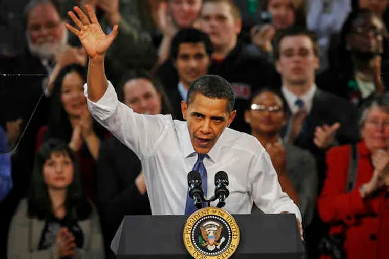 President Obama responds to supporters after speaking yesterday at Arcadia University in Glenside.