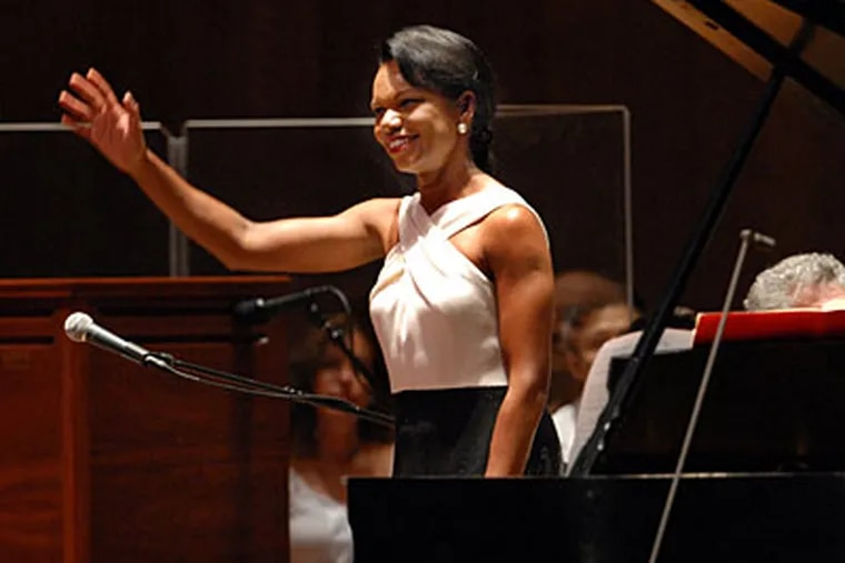Former Secretary of State Condoleezza Rice, a classically trained pianist, joined the Queen of Soul, Aretha Franklin, with the Philadelphia Orchestra at the Mann Center Tuesday night. Opponents of Bush-era policies had protested the concert, but Rice drew a warm reception last night. (APRIL SAUL / Staff Photographer)