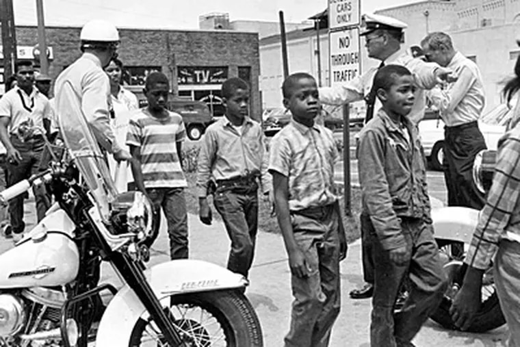 Schoolchildren being led to jail in Birmingham, Ala., on May 4, 1963. They were arrested for protesting near city hall against racial discrimination