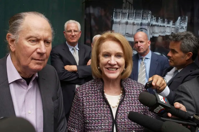 Seattle Hockey Partners David Bonderman (left) and and Seattle Mayor Jenny Durkan talk to the media as they leave an October meeting at the NHL headquarters in New York.