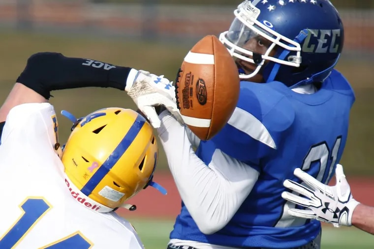 Conwell-Egan's Dajuan Harris (right) can't hold onto a pass as Middletown's Tre Leach defends in the first quarter of a PIAA Class 3A football semifinal Saturday, Dec. 2, 2017, at West Chester Rustin. Conwell-Egan went on to lose, 49-7.
