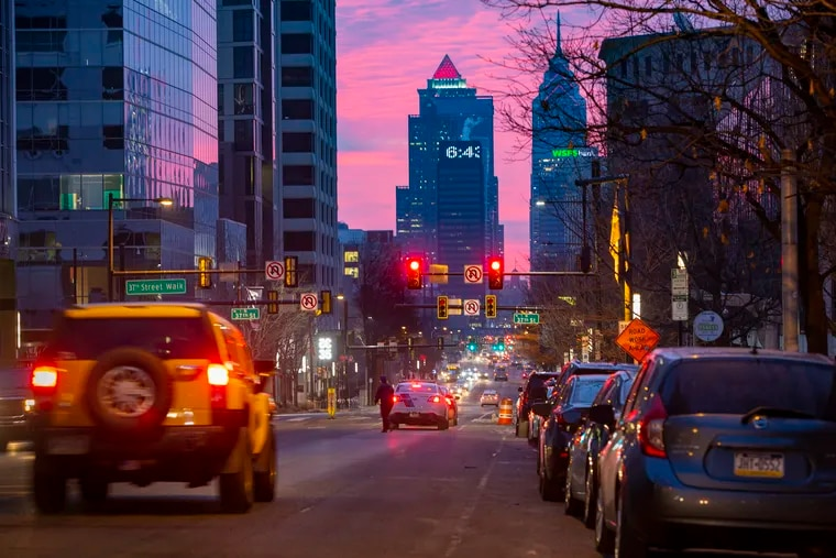 Commuters trickle into Philadelphia on a weekday morning in February. Officials aim to draw more into the city as the pandemic loosens its grip.