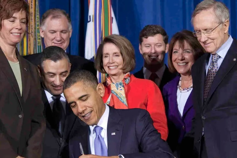 """Rep. Barney Frank (left) applauds repeal of """"Don't Ask, Don't Tell"""" legislation, signed by President Obama (above) yesterday."""
