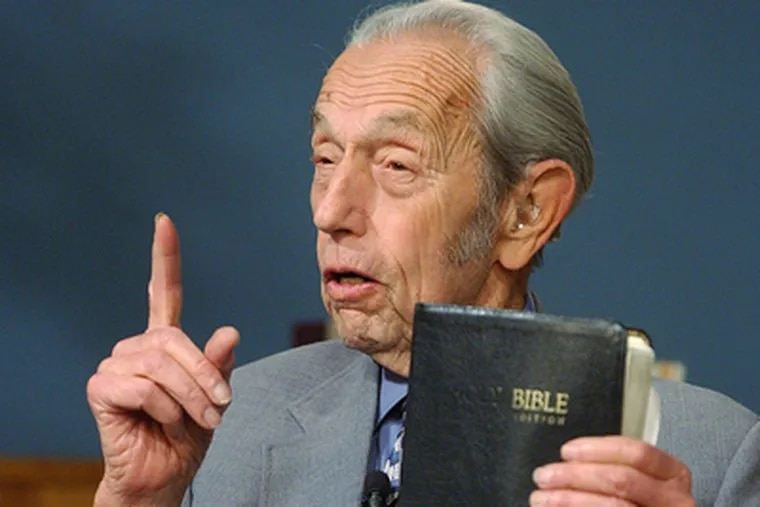 Harold Camping speaks while holding the Bible during his live television broadcast, Dec. 12, 2002, in San Leandro, Calif. (AP Photo)