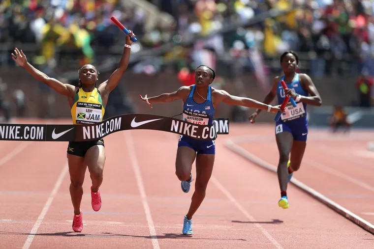 Jamaica's Jura Levy (left) edges out Kyra Jefferson, of USA Red, in the women's 4x100 USA vs. the World event at last year's Penn Relays. The wildly popular showcase is entering its 20th running.