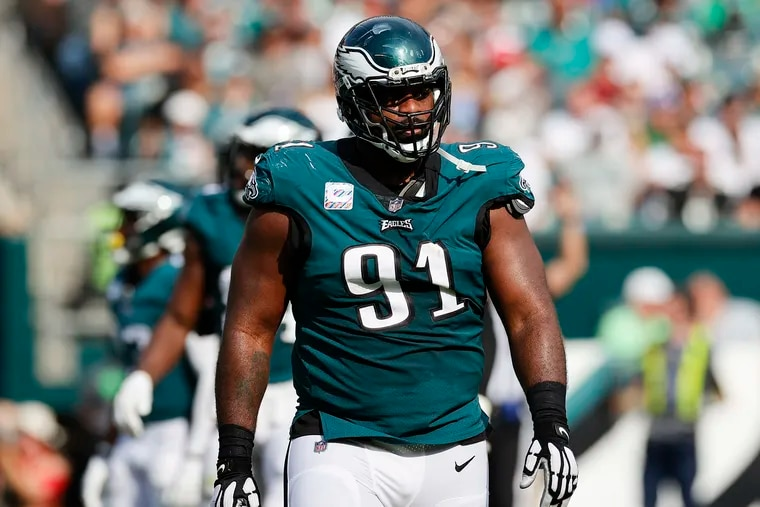 Eagles defensive tackle Fletcher Cox walking off the field against the Kansas City Chiefs on Sunday.