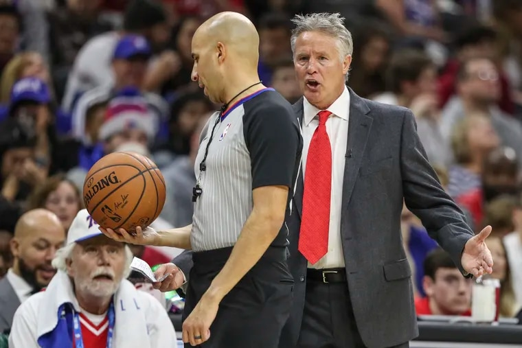 Sixers coach Brett Brown talks to the referee in the first half of the victory over the Bucks.