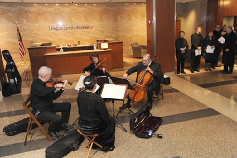 Musicians protest the Philadelphia Orchestra Association voting to file for bankruptcy. Clockwise from left, Davyd Booth, Pamela Fay, Lloyd Smith, and Nancy Bean perform. (April Saul / Staff Photographer)
